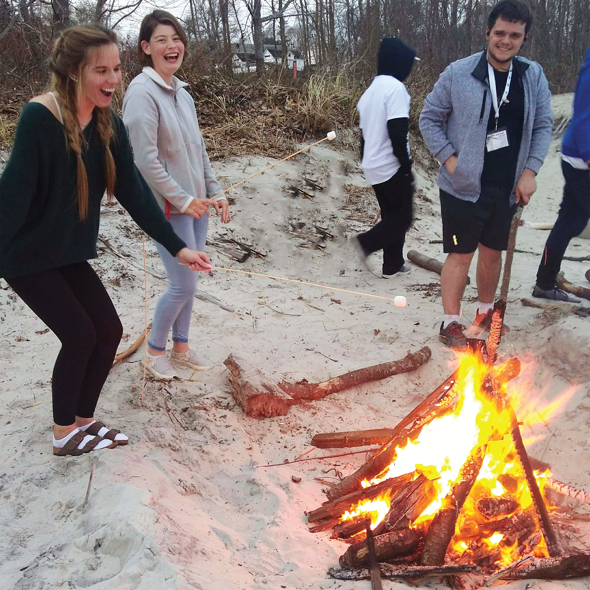Students at bonfire on Mitchell Beach